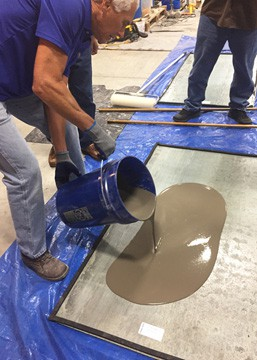 Pete Trainor, VP Sales at PENETRON Specialty Products, shows how easy it is to pour the LEVELINE self-leveling underlayment to a floor surface
