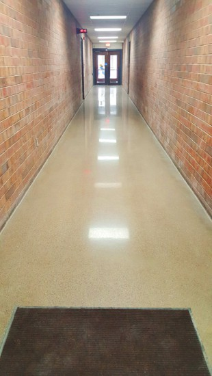 The hallway of the Waukesha County Technical College is fully restored thanks to PSP's RENEW WS, a single component, self-leveling overlayment.
